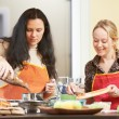 Two woman cooking in kitchen — Stock Photo