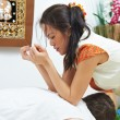 Traditional thai massage health care back kneading - Stock Photo