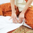 Traditional thai massage health care foot kneading - Stock Photo