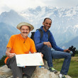 Two smiling tourist hiker in india mountains — Stock Photo #19040441
