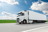 White lorry with trailer over blue sky — Stock Photo