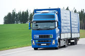 Blue lorry with trailer over blue sky — Stock Photo