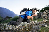 Thirsty tourist hiker in india mountains — Stock Photo