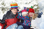 Happy family with child in winter — Stock Photo