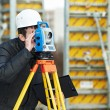 Surveyor works with theodolite — Stock Photo #19677153