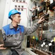 Happy electrician working at power line box — Stock Photo