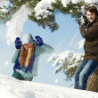 Young peolple playing with snow in winter — Stock Photo