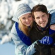Young happy couple in winter - Stock Photo