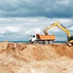 Wheel loader excavator and tipper dumper — Stock Photo