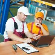 Royalty-Free Stock Photo: Manual workers in warehouse