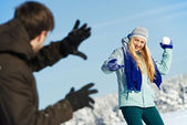 Young peolple playing snowballs in winter — Stock Photo