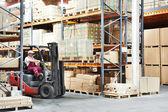 Worker driver at warehouse forklift loader works — Stock Photo