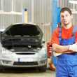 reparateur auto mechanic inspecteur — Stockfoto
