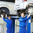 Auto mechanic at car suspension repair work — Stock Photo #19786831