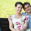 Smiling young couple at spring outdoors — Stock Photo