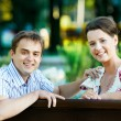 Smiling young couple at spring outdoors — Stock Photo #19786851