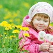 Baby with spring dandelion — Stock Photo #20177619
