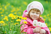 Baby with spring dandelion — Stock Photo