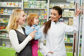 Pharmacy chemist, mother and child in drugstore — Foto Stock