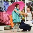 Woman and little girl shopping clothes — Stock Photo #20424331