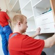 Wardrobe joiners at installation work — Stock Photo #20509561