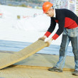 Roofer worker installing roof insulation material — Stock Photo #20509631