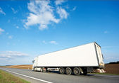 Back of white lorry trailer over blue sky — Stock Photo