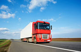 Red lorry trailer over blue sky — Stock Photo