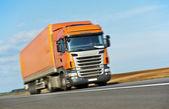 Orange lorry trailer over blue sky — Stock Photo