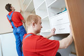 Wardrobe joiners at installation work — Stock Photo