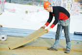 Roofer worker installing roof insulation material — Stock Photo