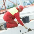 Builder worker stop up concrete slab — Stock Photo