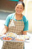 Indian tibetan Woman waitress with tray — Stock Photo