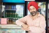 Young adult indian sikh seller man — Stock Photo