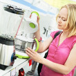 Stock Photo: Womshopping at home appliance supermarket