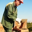 Construction mason worker bricklayer - Stock Photo