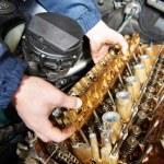 Machanic repairman at automobile car engine repair — Stock Photo