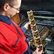 Machanic repairman at automobile car engine repair — Stock Photo #21440511
