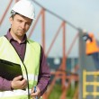 Builder manager worker at construction site - 