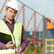 Builder manager worker at construction site - Lizenzfreies Foto