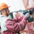 Worker installing glass window on building — Stock Photo