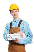 Worker in hardhat and overall with drafts — Stock Photo