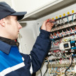 Electrician at voltage adjusting work — Stock Photo #21478725