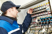 Electrician at voltage adjusting work — Stock Photo