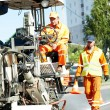 Stock Photo: Workers at road surface pavement markings