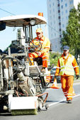 Workers at road surface pavement markings — Stock Photo