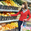 Woman shopping fruits - Stock Photo