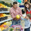 Family with child shopping fruits — Stock Photo