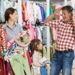 Woman and little girl shopping clothes — Stock Photo #21625421