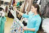 Young woman at clothes shopping — Stock Photo